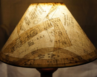 Unique lamp shade covered in vintage paper patterns gives a warm conversational glow