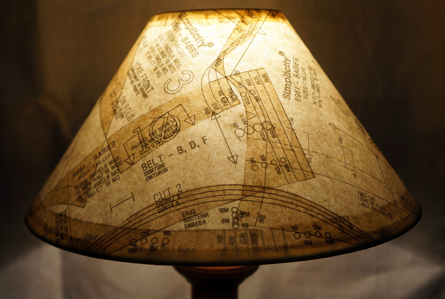 Unique lamp shade covered in vintage paper patterns gives a zoom aloadofball Choice Image