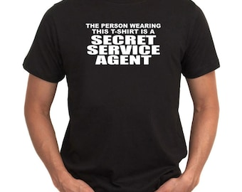 The Person Wearing This T Sshirt Is A Secret Service Agent T-Shirt