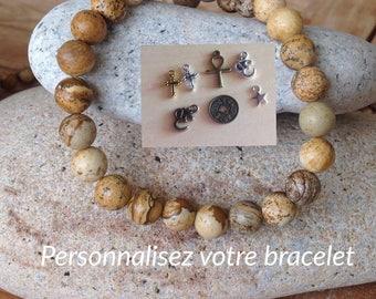 DIY beads bracelet. Buddhist, cross