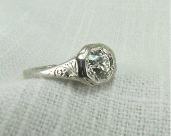 On Sale!  Appraisal Value: 9400.  Circa 1920's Platinum Engagement Ring set with 0.83 CT VS 1 Old European Cut Diamond