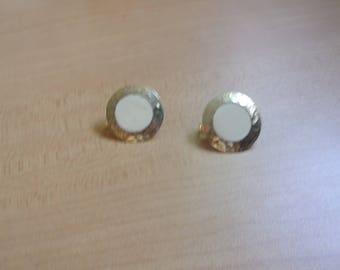 vintage clip on earrings hammered goldtone circles ivory colored enamel