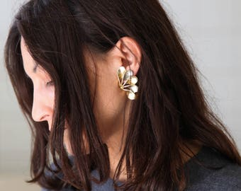 Unique vintage over sized clips brass earrings.