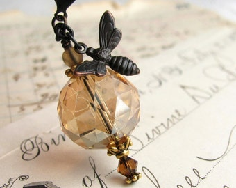 Golden honey bee necklace made with Fallen Angel Brass, champagne crystal ball glass beads, honey bee pendant, gold accents, insect jewelry