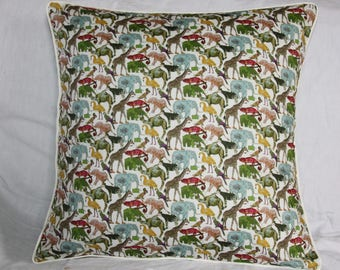 Cushion cover in Liberty Queue for the Zoo, cotton green, ecru piping