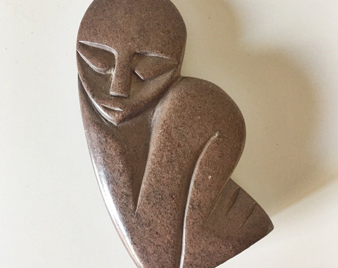 abstract chestnut carved stone figure