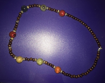 Gorgeous, Big Bold Necklace with round chocolate wood beads and Big Glass Beads with a touch of sparkle.