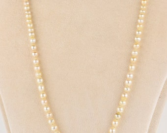 A rare Edwardian natural Basra pearl single strand necklace with original clasp