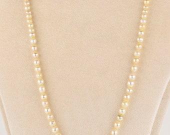 A rare Edwardian natural Basra pearl single strand necklace with original clasp
