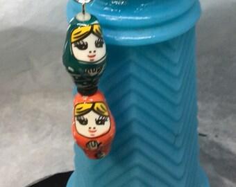 Ceramic Nesting Doll FOB: Dark Green/Orange