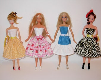 Handmade barbie clothes! lot of 4 dresses with bags for Barbie doll.
