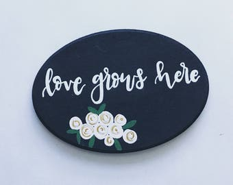 hand painted canvas // love grows here