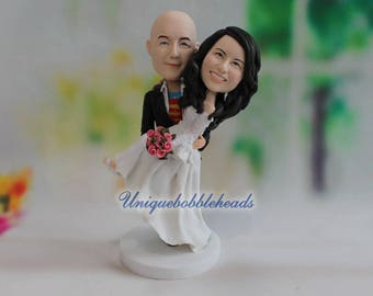 groom holding bride, on his arm, marry, anniversary cake topper, anniversary gift, wedding gift, bride gift, groom gift, gift for bride