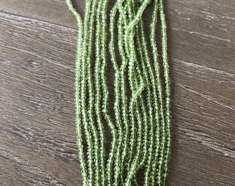 CLOSEOUT Peridot Faceted Rondelles 1 Strand