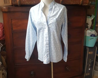 Size 10 handmade vintage shirt pale blue floral long sleeved blouse with pockets.