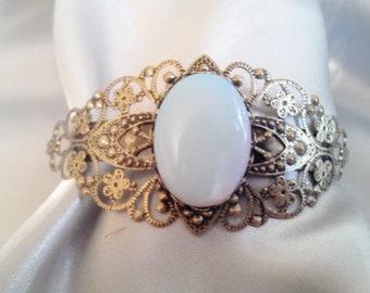Antique bronze filigree bracelet with Opal cabochon