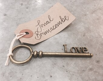 Handwritten Wedding Place Name Tags attached to Antique Keys. Cool, Calligraphy, Modern Design, Table Settings, Party.