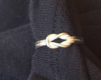 Sterling silver ring love knot design