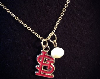 Red STL Cardinals logo with white bead