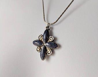 Blue Four Petal Pendant Necklace on a flat silver chain