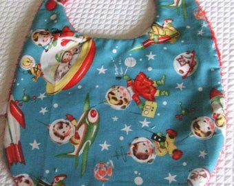 Turquoise bib with little characters