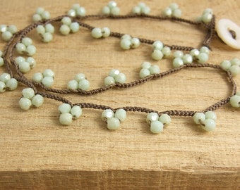 Necklace with Opaque, Light Turquoise Colored Czech Glass Beads, Hand Crocheted in Clusters on to a Brown Cord SN-395