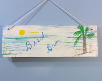Shabby Chic wall art painting on wood. Beach Bum is a great vacation attitude. Pretty beach with palm tree, sun, and blue sky.
