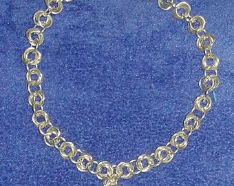 Stirling silver chainmaille bracelet with with small knot detail.