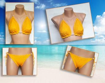 Swimwear crocheted women. Bikini Women swimwear Separate swimsuit top and yellow shorts. Knitted swimsuit Summer trends