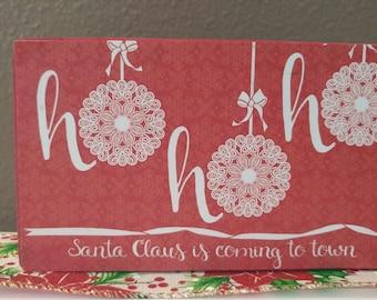 Ho, Ho, Ho. Santa Claus is Coming to Town