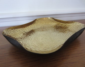 Brass tray.  Hammered with a curvy rim and black enamel underside.   Brass bowl  tray  entry catch all.  Unique brass art.