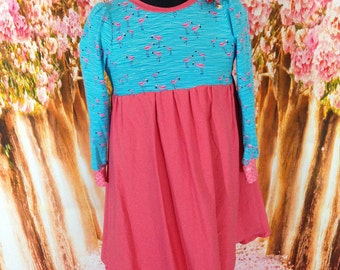 Dress of size 122 with wide swinging skirt