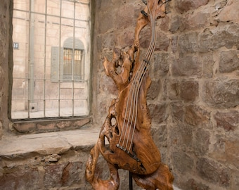 An Abstract Handcrafted Guitar Sculpture, Made of Old Olive Wood  from the Holy Land