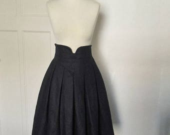 Box pleated, tea length skirt in classic BLACK.  Full midi skirt with high, shaped waist. Available in sizes XS-XL or made to measure.