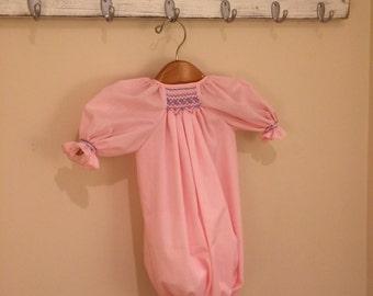 Pink smocked drawstring gown.