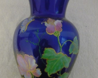 Hand painted blue glass vase painted with pink flowers and butterfly