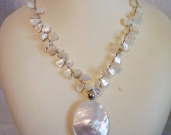 Estate jewelry, vintage hand knotted mother of pearl necklace