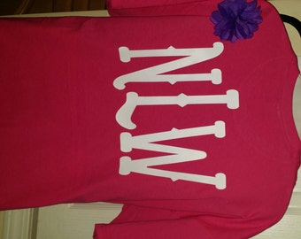 Fancy font type T-shirt. Comes in different colors and sizes.