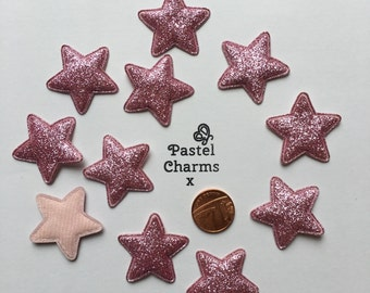 Pack of 10 pink glitter star embellishments