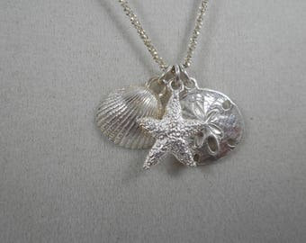 Vintage Sterling Silver Beach/Ocean Charm Necklace 18 inch ,Shell ,Starfish and Sand Dollar Charm Necklace