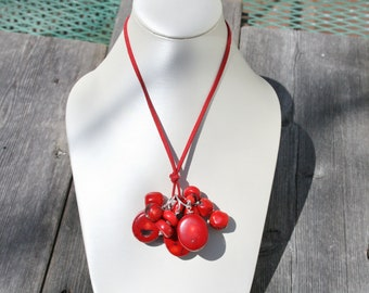 Large genuine red cora stones, approx 26mm each hanging from 3 large sterling loop and 9 smaller ones. All with sterling silver balls