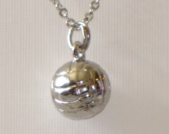 Volleyball necklace with 3D volleyball charm in silver plated metal on metal 1mm chain.