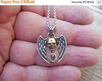 ON SALE Winged skull necklace handmade in sterling silver  and brass with a sky blue topaz