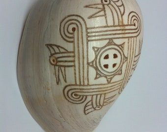 Engraved Melo Shell: Cherokee Indian Sunwheel with the red-headed Woodpecker Motive (Shell Type  Voluta Melcoorona)