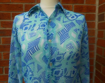 Beautiful 1970s synthetic sheer blouse to fit small 8/10