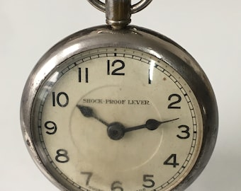 Swiss Shock proof lever pocket watch with plane engraved on the Back