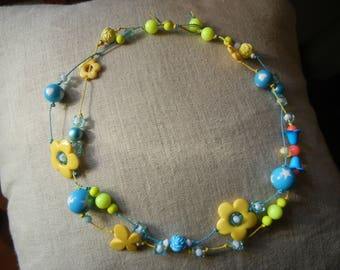 yellow and blue summer necklace with butterflies and flowers