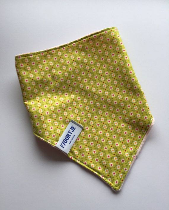 Green toddler ajustable bandana with sweet retro 70's flowerprint, and super soft minky back.
