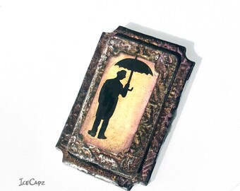 Steampunk Umbrella Man Silhouette handmade painted resin-coated magnet.