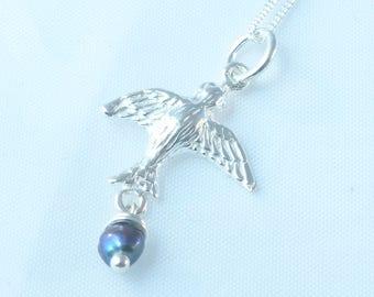 silver bird pendant